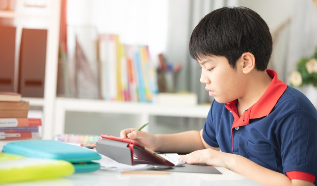 male student studying math